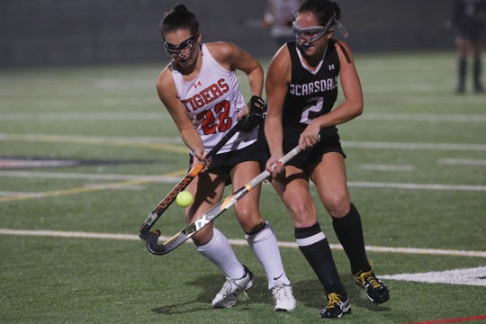 From left, Mamaroneck's Amanda Zerbib (22) and Scarsdale's Liz Scarcella (2) battle for ball control during field hockey playoff action at Mamaroneck High School Oct. 30, 2019. Mamaroneck won the game 2-0.