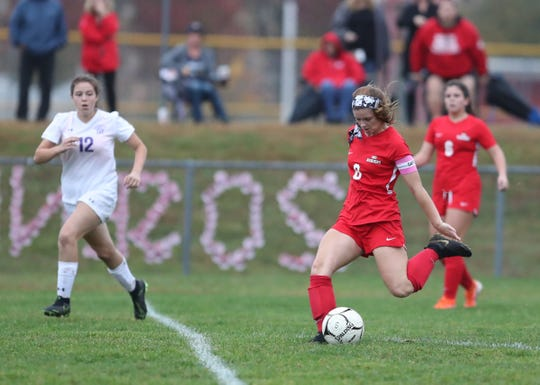 North Rockland's Jenna MacMillan (8) takes a shot on goal during their 3-0 win over New Rochelle the Section 1 girls Class AA soccer semifinal game at North Rockland High School in Thiells on Thursday, October 31, 2019.