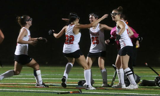 Mamaroneck players celebrate their 2-0 victory over Scarsdale during field hockey playoff action at Mamaroneck High School High School Oct. 30, 2019.