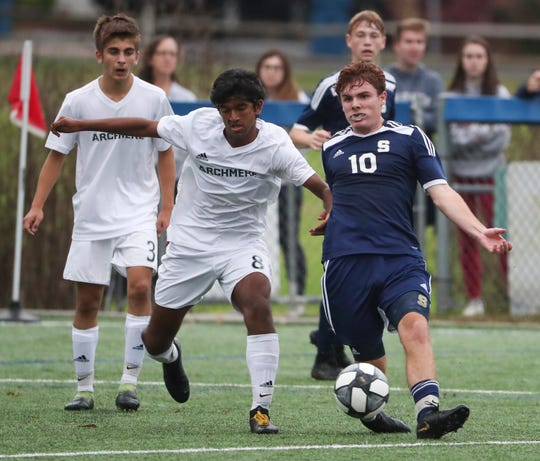 Archmere's Rishi Subbaraya (left) and Salesianum's Andrew Blackwell battle for possession during the Sals' 3-1 win last Wednesday at Hockessin Soccer Club.