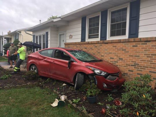 Police are investigating after this car crashed into a home on Rolling Drive in Newark.