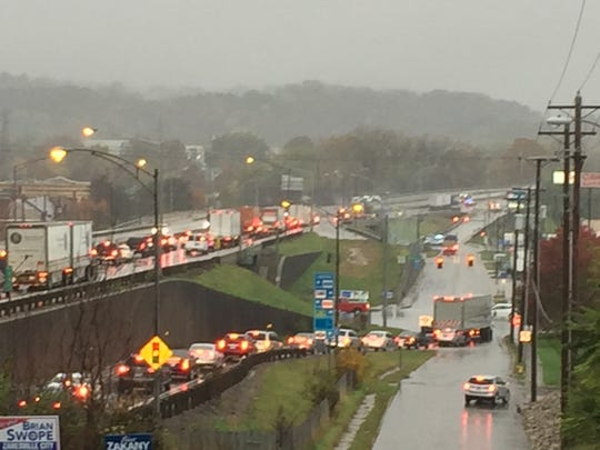Traffic is backed up as crews work on a semi that jackknifed around 8:30 a.m. on I-70, near the Maple Avenue exit.
