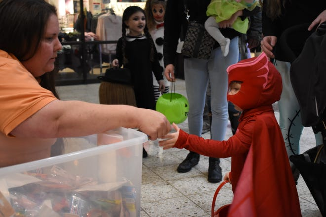 Most storefronts in the mall had employees handing out candy to children Thursday night. To view more photos visit www.zanesvilletimesrecorder.com.