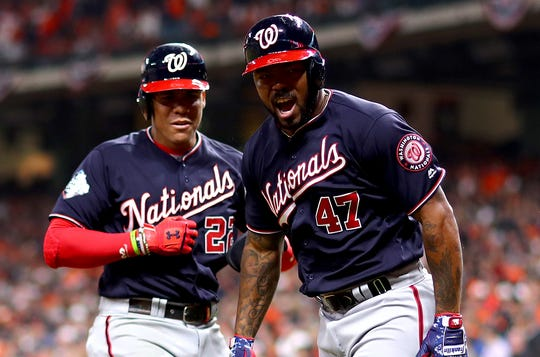 HOUSTON, TEXAS - OCTOBER 30:  Howie Kendrick #47 of the Washington Nationals is congratulated by his teammate Juan Soto #22 after hitting a two-run home run against the Houston Astros during the seventh inning in Game Seven of the 2019 World Series at Minute Maid Park on October 30, 2019 in Houston, Texas. (Photo by Mike Ehrmann/Getty Images) ORG XMIT: 775425081 ORIG FILE ID: 1184527659