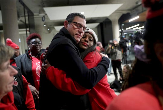 In this Wednesday, Oct. 30, 2019, Chicago Teachers Union President Jesse Sharkey and vice-president Stacy Davis Gates share a hug after speaking to the media following a CTU House of Delegates meeting at the Chicago Teachers Union Center in Chicago.  (Chris Sweda/Chicago Tribune via AP)