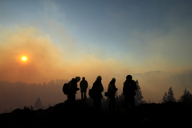 Firefighters monitor the Kincade Fire on October 29, 2019 in Healdsburg, California. Fueled by high winds, the Kincade Fire has burned over 76,000 acres and has prompted nearly 200,000 evacuations in Sonoma County and beyond.
