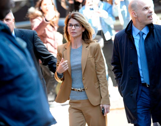 Actress Lori Loughlin (C) arrives at the court to appear before Judge M. Page Kelley to face charge for allegedly conspiring to commit mail fraud and other charges in the college admissions scandal at the John Joseph Moakley United States Courthouse in Boston, Massachusetts on April 3, 2019. (Photo by Joseph Prezioso / AFP)JOSEPH PREZIOSO/AFP/Getty Images ORIG FILE ID: AFP_1FC6UN