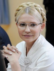 File photo taken in 2011 shows the former Ukrainian prime minister Yulia Tymoshenko during a trial hearing at the Pecherskiy District Court in Kiev.  (AP Photo/Sergei Chuzavkov, File)