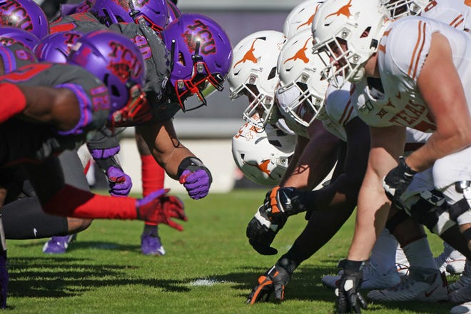 TCU and Texas linemen square off at the line of scrimmage on an extra point try in the first half Saturday, Oct. 26, 2019, in Fort Worth.
