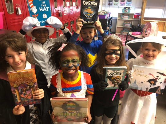 """Taylor Elementary second-grade students spent their Friday morning dressed up as their favorite storybook characters so they could parade through school with their favorite books. Lillian Buck, left, dressed as Hermione Granger from """"Harry Potter,"""" celebrated with classmates Braylon Shurme (The Cat in the Hat), Savannha Johnson (Camila Cream), Hudson Holt (Dog Man), Mallory Meeks (Princess in Black) and Ava Grant (Mary Poppins)."""