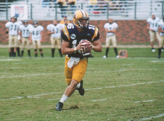 Former Hardin-Simmons quarterback Jordan Neal rolls out for a pass during a game against Howard Payne. Neal is in his first year as McMurry's head coach preparing for his first time coaching in the battle for the Wilford Moore Trophy.