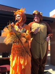 """Bowie Elementary principal Tina Jones, dressed as the goldfish from the 1967 book """"Brown Bear, Brown Bear, What Do You See?,"""" by Bill Martin Jr., leads the school's Storybook Character Parade Friday with the help of assistant principal Clay Johnson, who spent his day in a brown bear onesie for the celebration."""
