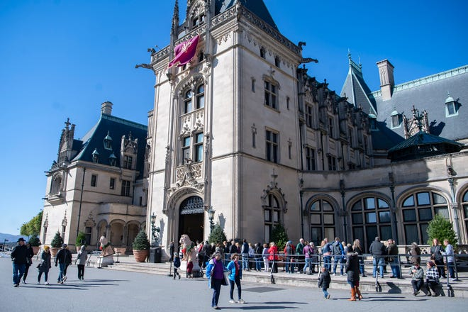 Visitors tour the grounds outside of the Biltmore House during the annual Biltmore tree-raising on the estate on Nov. 1, 2019.