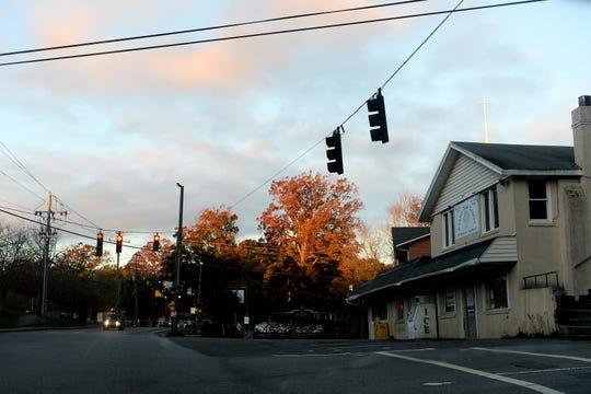 A tree is lit orange by the rising sun in Oakley on Nov. 1, 2019.
