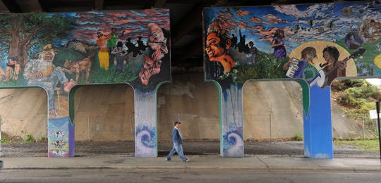 The underpass of Interstate 240, marked by murals, is near the point where three new state House districts converge.