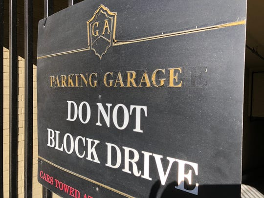 The Grove Arcade's parking garage, located beneath the main building, holds about 120 vehicles. While spaces are empty at times, the property owner says renters are guaranteed a space.