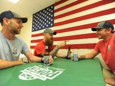 Marine Veterans Michael Neder, left, Justin Rice, center, and David Hana meet inside Black Mountain VFW Post 9157.
