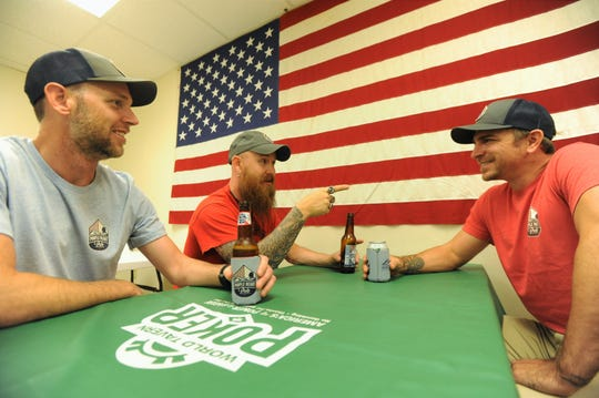 Marine Veterans Michael Neder, left, Justin Rice, center, and David Hana meet inside Black Mountain VFW Post 9157.