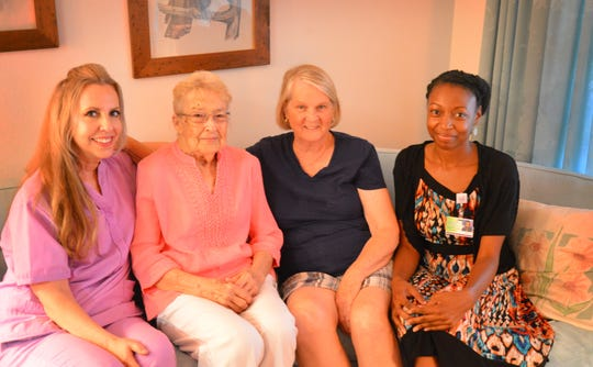 "Sylvia Knight visits with the women she calls her ""angels."" From left are hospice nurse Liz Walther, Knight, Knight's neighbor Linda Allen and social worker Sabrina Poaches. Knight is being cared for in her home by Hospice of St. Francis."
