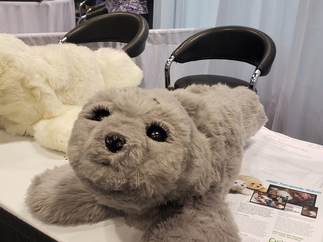 PARO is a therapeutic robot used with dementia patients that recognizes its own name and reacts to touch, sound, light, heat and movement with cute cooing sounds.