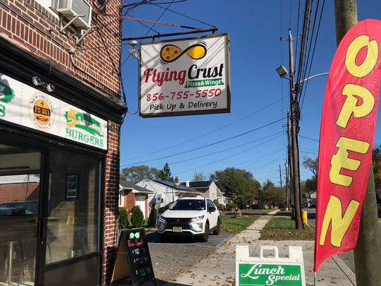 Flying Crust pizza and wings shop on Park Avenue in Pennsauken opens following repairs made after a car crashed through is storefront May 3, 2019, while the business was open . A local teacher has been charged in the accident with drunken driving and assault by auto beause several employees were injured.