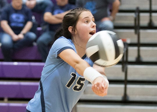 Adena's Camryn Carroll digs a ball during a 3-0 loss to Wheelersburg in a Division 3 regional semifinal game at Logan High School on Thursday, October 31, 2019.