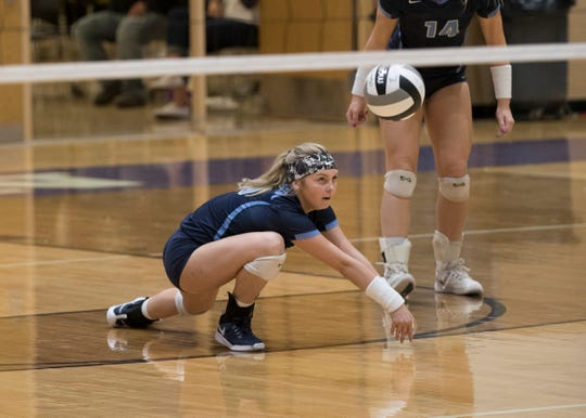 Adena's Hope Garrison digs a ball during a 3-0 loss to Wheelersburg in a Division 3 regional semifinal game at Logan High School on Thursday, October 31, 2019.
