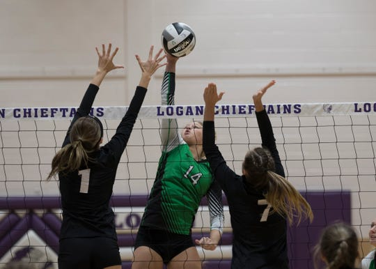 Huntington's Allison Basye spikes a ball during a 3-0 loss in a Division 3 regional semifinal game against Berlin Hiland at Logan High School on Thursday, October 31, 2019.