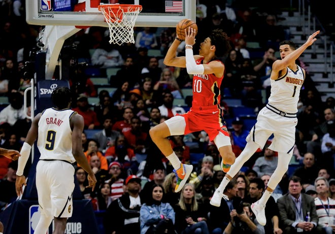 New Orleans Pelicans center Jaxson Hayes (10) is defended by Denver Nuggets forward Michael Porter Jr. (1) during the first quarter at the Smoothie King Center on Oct. 31.