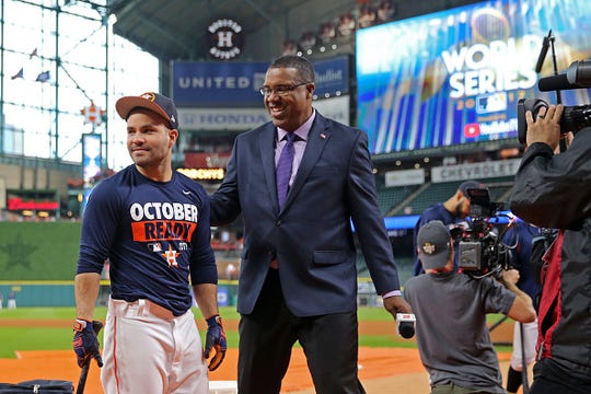 Jose Altuve of the Houston Astros jokes with ESPN analyst Eduardo Perez during batting practice prior to Game 3 of the 2017 World Series against the Los Angeles Dodgers at Minute Maid Park on Friday, October 27, 2017 in Houston, Texas.