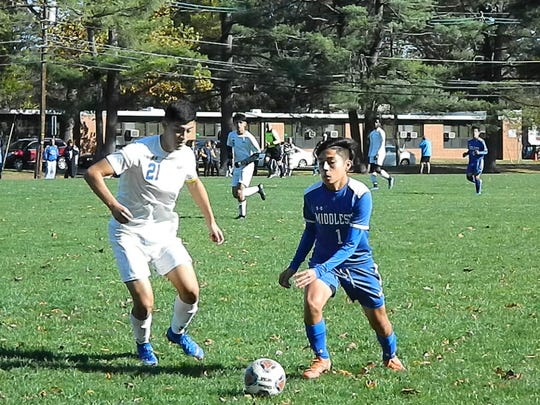Middlesex's Gabriel Tacco (1) looks to get around Manville's Joel Betancourt during their NJSIAA Central Group I quarterfinal on Friday, Nov. 1, 2019.