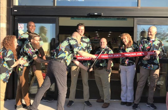 Store captain Mark Sorhage cutting the ribbon with other employees of the new Trader Joe's at the Bridgewater Promenade on Friday, Nov. 1, 2019.