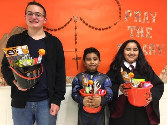 Saint Helena School Halloween writing contest. Congratulations to the winners of the three grade categories, Justin Kolodziej, Pranshu Patel, and Elizabeth Manuel. (left to right)