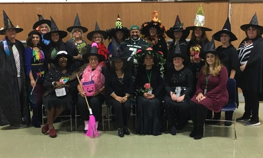 "Saint Helena's teachers decided to support the students annual Halloween writing contest by dressing up as different types of witches.  The short essay's topic was ""Which Witch is Witch"", and homophones had to be included.  Grades Kindergarten through 8 participated."