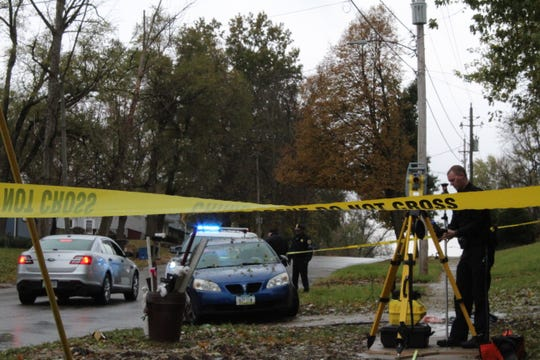 Police investigate the scene of a crash. A car struck an 8-year-old in the driveway of her home Friday, Nov. 1, 2019, resulting in serious injuries.