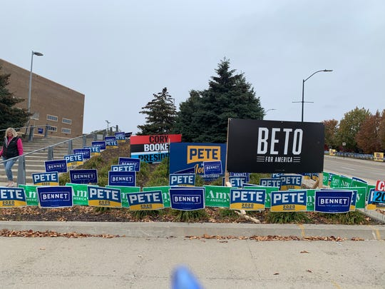 Campaign signs sit across from Wells Fargo Arena ahead of Friday's Liberty and Justice Dinner. Beto O'Rourke dropped out of the presidential race before his pre-dinner rally began.