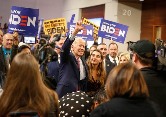 Former Vice President and current democratic presidential candidate hopeful Joe Biden waves to supporters on Friday, Nov. 1, 2019, en route to Wells Fargo Arena in Des Moines for the Iowa Democratic Party Liberty and Justice Celebration.
