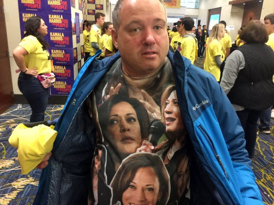 A Kamala Harris supporter shows off his shirt before her rally at the Iowa Events Center on Friday. Downtown Des Moines is crammed full of presidential candidates holding parties and rallies ahead of the Liberty and Justice Celebration.