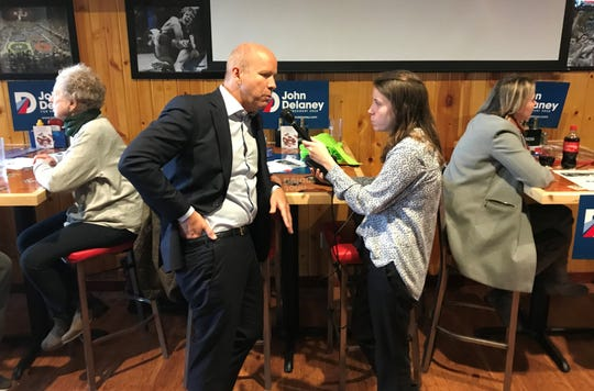 John Delaney speaks to a reporter during his supporters rally at Buzzard Billy's in downtown Des Moines on Friday.