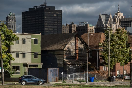 Detroit's downtown skyline is seen over some new buildings and existing residential homes in Detroit's North Corktown neighborhood on Thursday, Oct. 11, 2018.