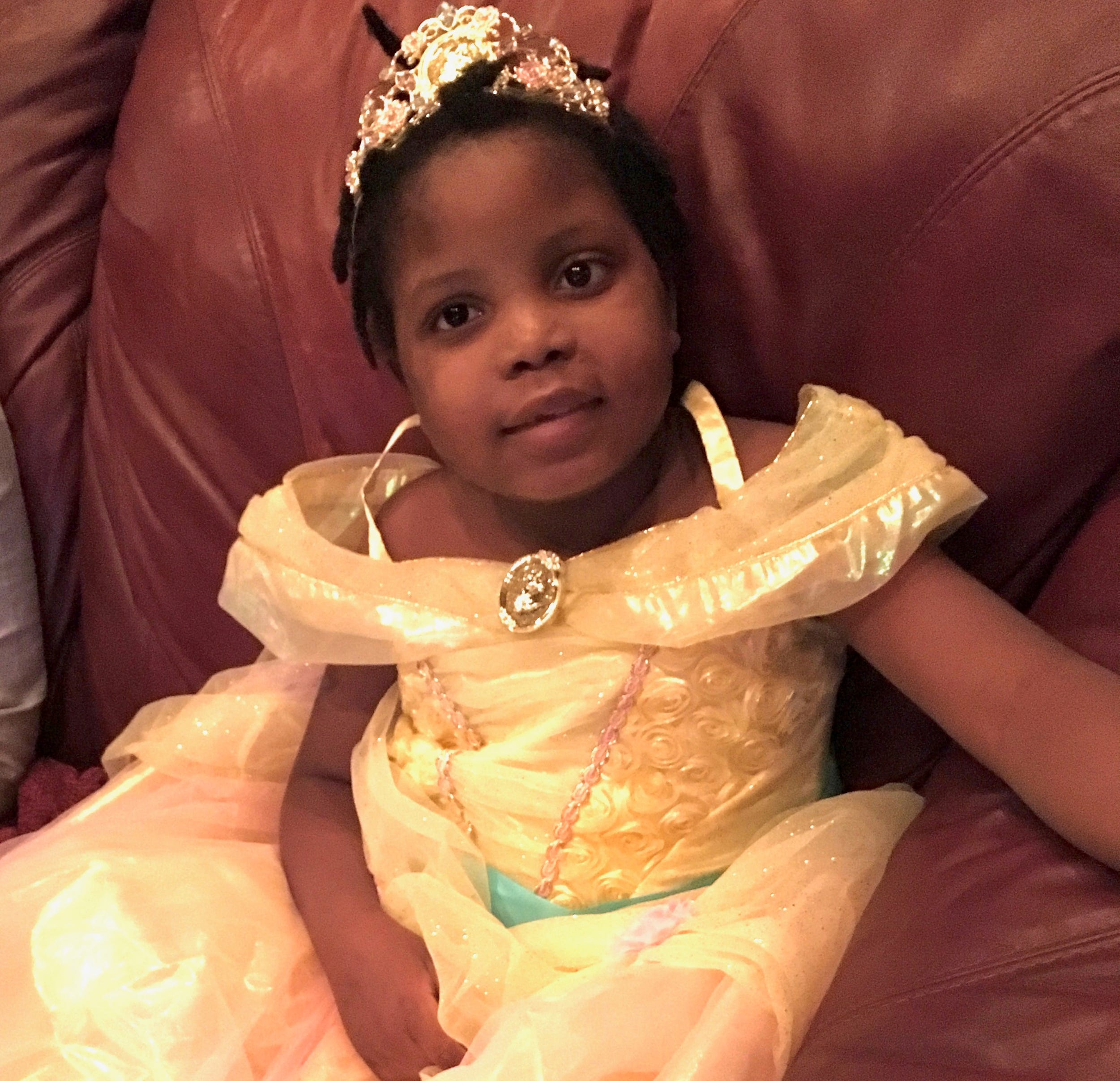 """Chika in a fun, frilly princess dress, like the one worn by Belle in """"Beauty and the Beast."""""""