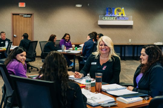 ELGA Credit Union employees talk to their groups during a continued professional development training course at the ELGA Administration and Conference Center Building in Burton on Wednesday, October 23, 2019.