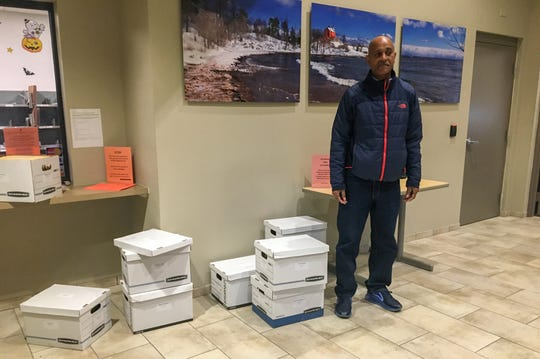 Calvin Mahew, a courier for Butzel Long law firm in Detroit, who dropped off nine boxes of documents for three different clients on the first day that the state Marijuana Regulatory Agency began accepting applications for the recreational marijuana market.