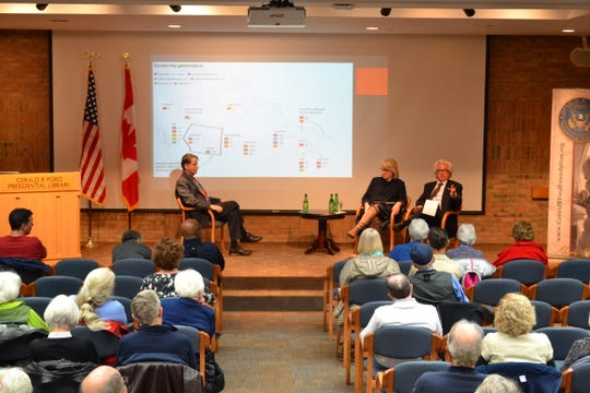 """Professor Barry Rabe from the University of Michigan's Ford School of Public Policy (left) moderating a discussion on """"The 2019 Canadian Election: Issues and Impact for Michigan"""" with Maryscott Greenwood of the Canadian American Business Council and Professor Steve Brooks of the University of Windsor at the Ford Presidential Library in Ann Arbor, Michigan. October 24, 2019."""