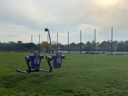 Blocking sleds stand unused on the football field at De La Salle Collegiate High School on Friday, November 1.