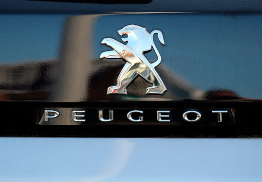A Peugeot logo pictured on a car in Bayonne, southwestern France, Thursday, Oct.31, 2019.