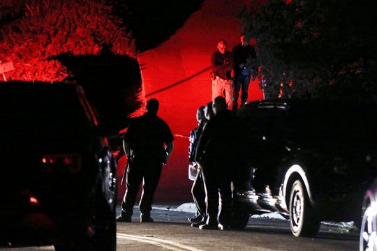 Contra Costa County Sheriff deputies investigate a multiple shooting in Orinda, Calif., on Thursday, Oct. 31, 2019. Four people were killed and four others wounded in a Halloween night party shooting at a large rental home in a wealthy San Francisco Bay Area community, police said Friday.