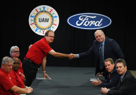 UAW President Gary Jones and Jim Hackett, President and CEO of Ford Motor Company, shaking hands, at the start of contract negotiations. Local United Auto Workers leaders on Friday voted to send a tentative agreement for hourly employees with Ford Motor Co. to its more than 55,000 employees for a ratification vote.