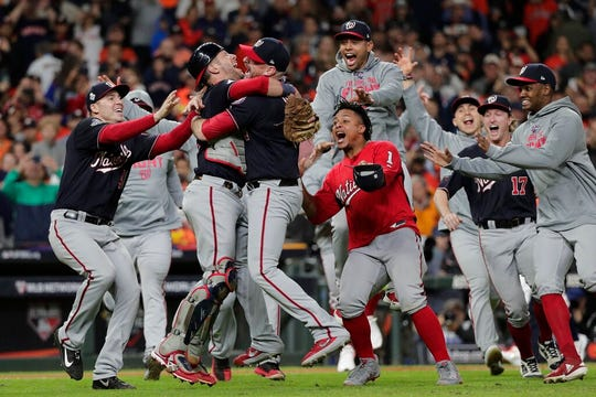 Washington Nationals' Yan Gomes and Daniel Hudson celebrate after Game 7 of the baseball World Series against the Houston Astros Wednesday, Oct. 30, 2019, in Houston. The Nationals won 6-2 to win the series.