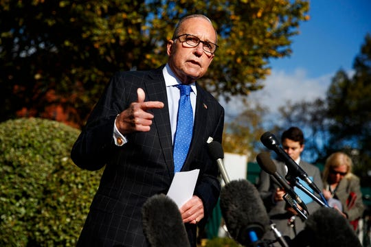 White House chief economic adviser Larry Kudlow talks with reporters outside the White House, Friday, Nov. 1, 2019, in Washington.